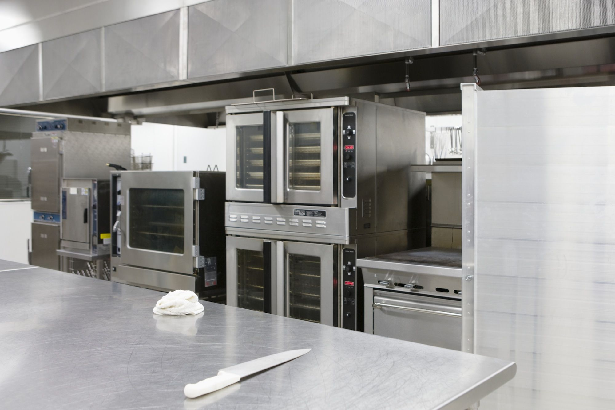 Complete stainless steel kitchen installation including sinks, worktops & units in London